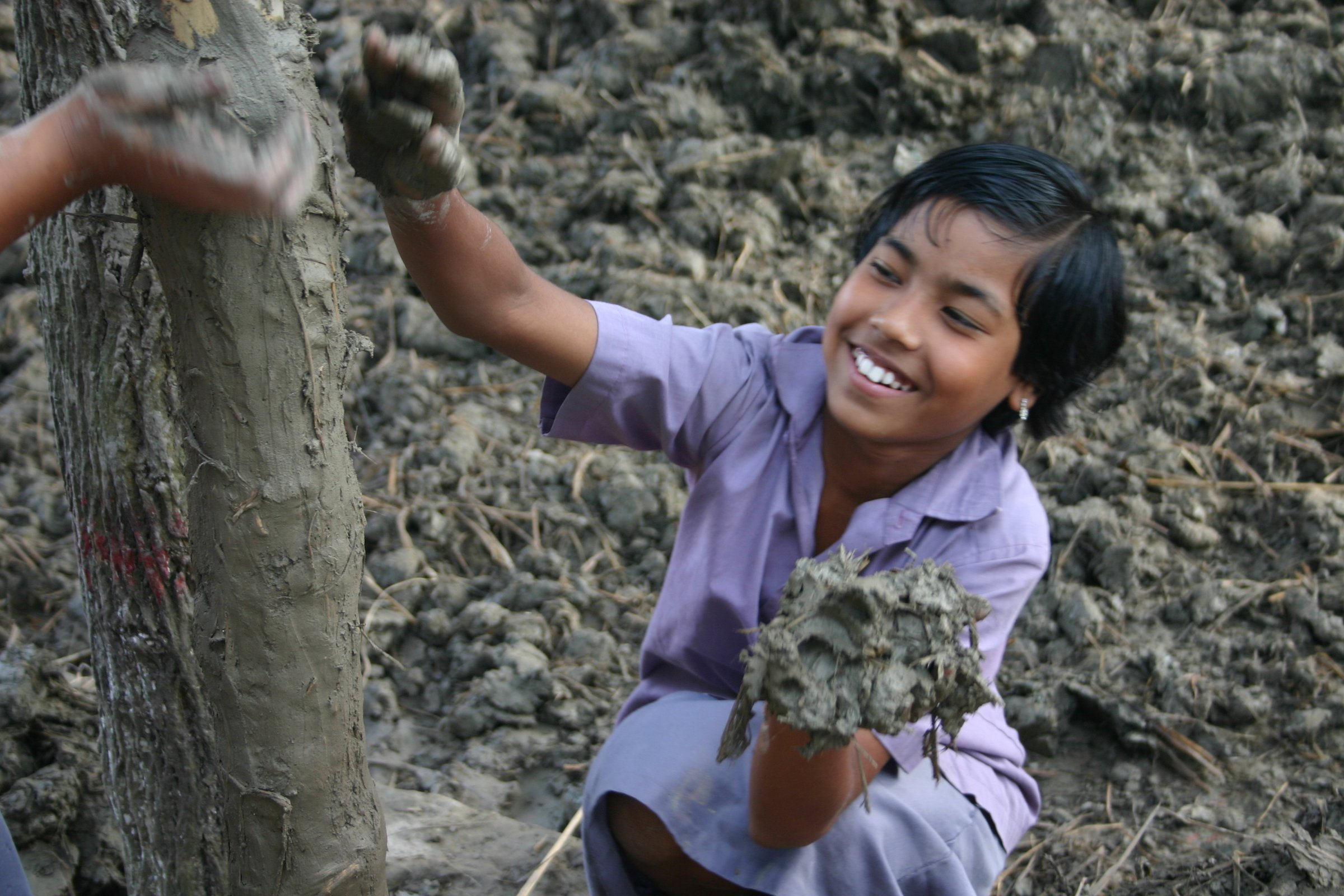 The METI School in Bangladesh used mud for walls and employed local people and craft throughout the project.