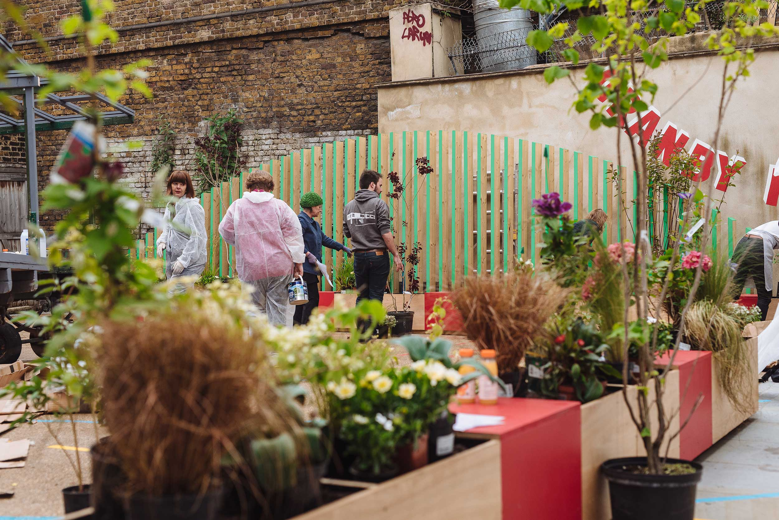 Lower Marsh, Waterloo. 'Meanwhile' projects can have an outsize impact on community life. IF_DO's transformation of a single-storey building and adjacent yard provided the community with affordable workspace and a public square while the building was awaiting redevelopment.