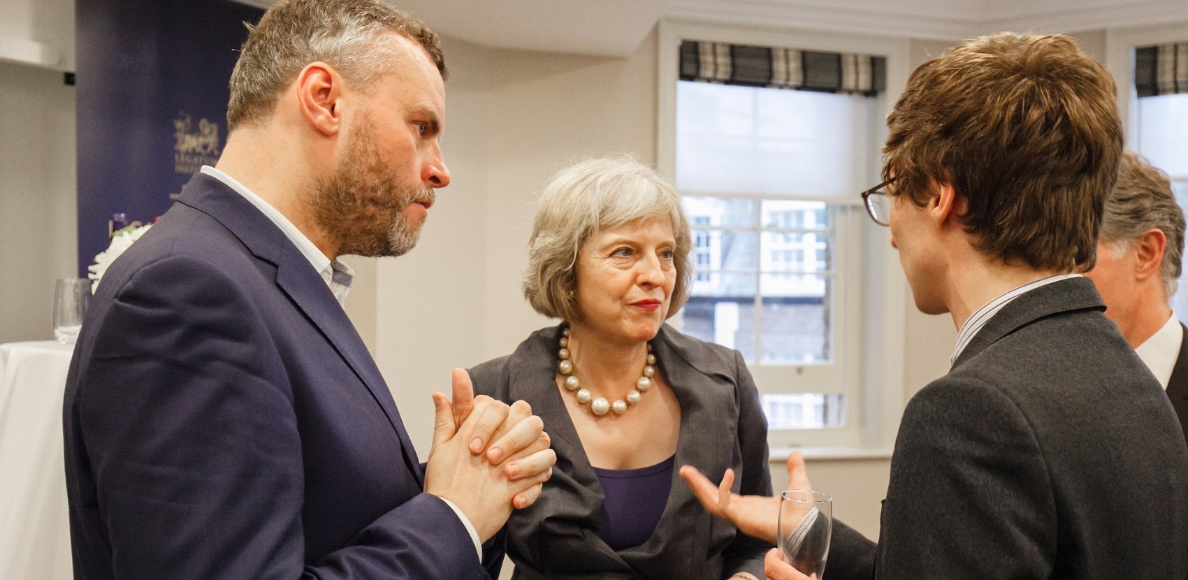 Fig. 29. Charlotte Skene Catling and I discussing the LSA with Theresa May at the summer party of the Legatum Institute, where I was a fellow.