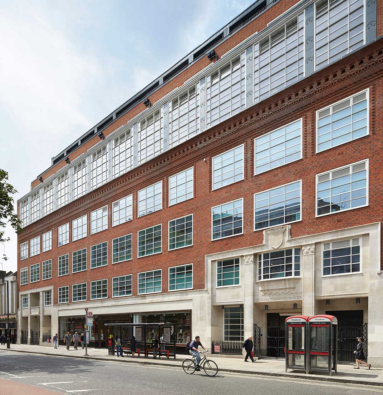 Former St Martin's School of Art, now Foyles Bookshop, Charing Cross Road, London. Architects London Country Council (Chief Architect E. P. Wheeler), 1939. Converted by Liftschutz Davidson Sandilands, 2014. Out of step with the smoothness of Modernism, and yet far from an exercise in historical style, this building is one of the most original pieces of work to come out of the LCC Architects in their neglected inter-war years. It seems to carry forward the ambitions of W. R. Lethaby, the theorist who at the turn of the century hoped that modern architecture could grow out of the past rather than requiring a dramatic rupture with it. Lethaby hated overdone elevations, but this one shows an adaptation to the internal purposes combined with decorative flair and good craftsmanship.
