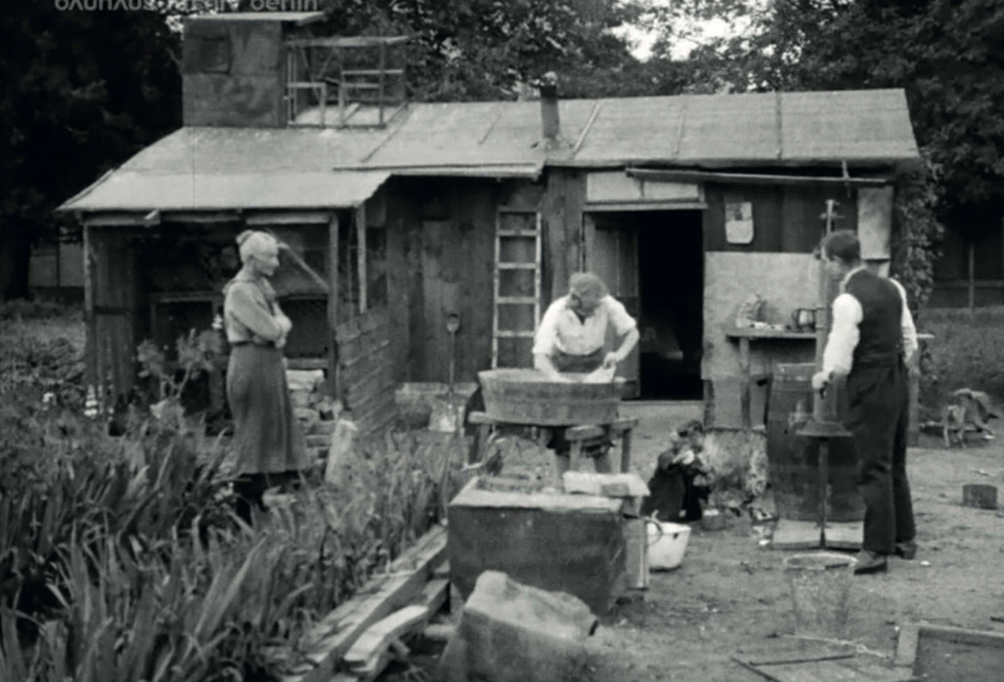 Conditions are equally bad for the hundreds of thousand allotment sheds where cooking, sleeping and living activities share the same space. Image from: How to live healthily and economically? Film series in four episodes by Walter Gropius and the Humboldt film GMBH, 1926.