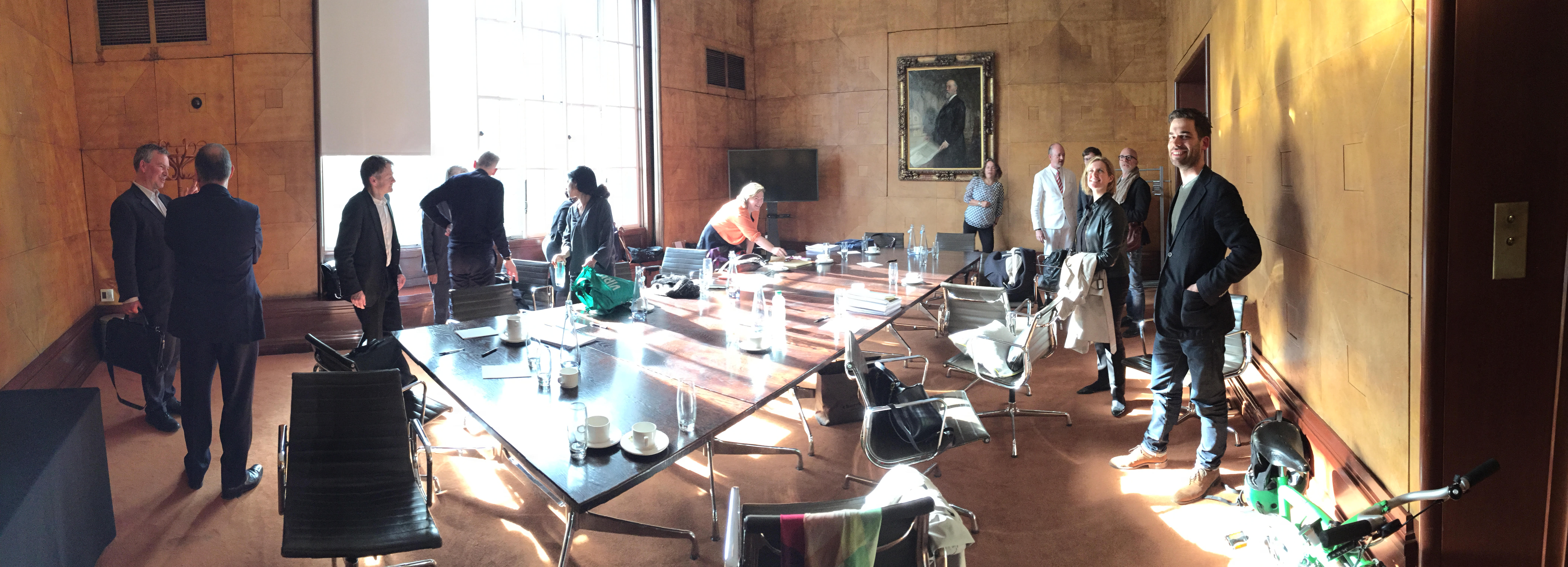 Fig. 30. The validation event at RIBA, from left, Alan Powers, unknown, Tom Holbrook, two unknown, Shumi Bose (turning to window), two women from London Met, a dapper James Soane, Will Hunter, eclipsed by Deborah Saunt, Nigel Coates and a grinning Lewis Kinneir.